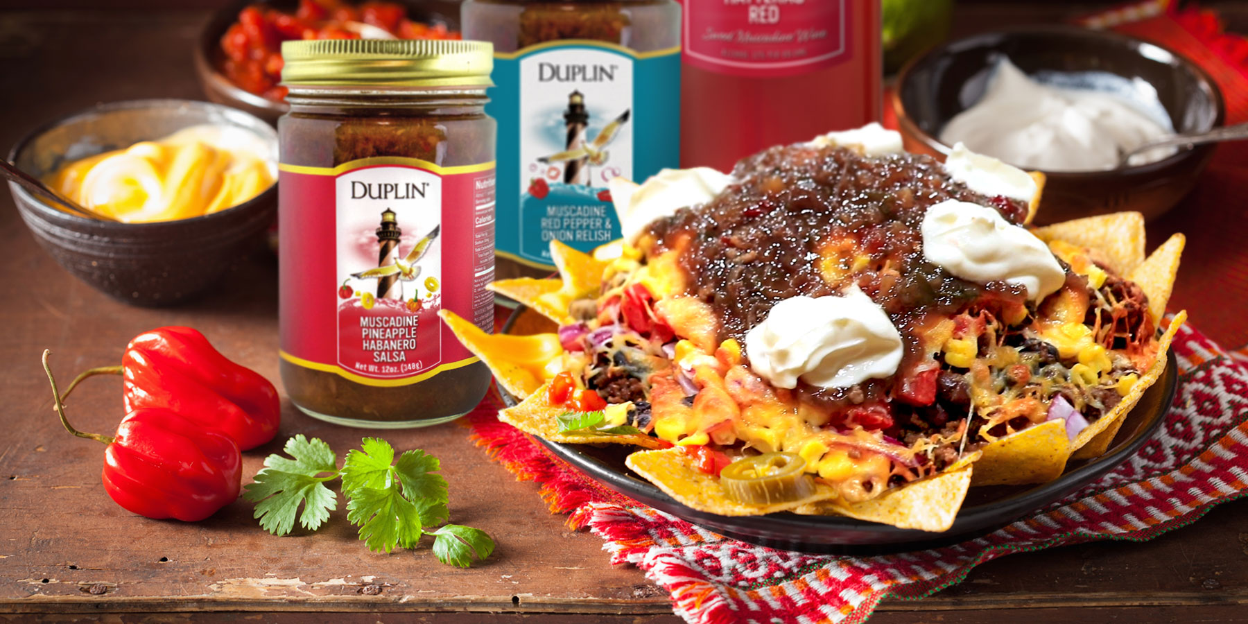 A platter of nachos is one of the easiest meals you can make at home and pairs perfectly with Duplin Hatteras Red.